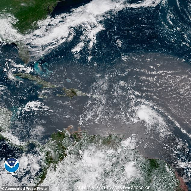 In this Geocolor image, GOES-16 satellite image Sunday, July 8, 2018, at 15:00 UTC, shows Tropical Storm Beryl, center right, across the Lesser Antilles in the Eastern Caribbean, and Tropical Storm Chris, top left, in front of the US East Coast. (NOAA over AP)