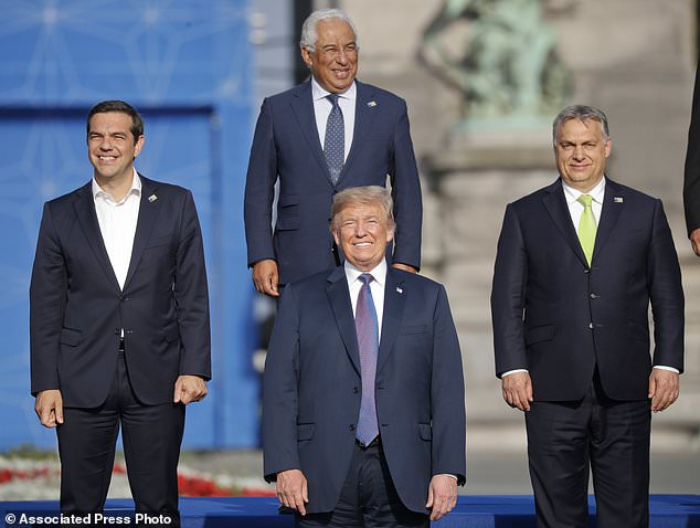 President Donald Trump, center, with from left, Greek Prime Minister Alexis Tsipras, Portuguese Prime Minister Antonio Costa and Hungarian Prime Minister Viktor Orban, pose during a group photo of NATO heads of state and government at Park Cinquantenaire in Brussels, Belgium, on Wednesday, July 11, 2018. NATO leaders gathered in Brussels Wednesday for a two-day summit to discuss Russia, Iraq and their mission in Afghanistan.(AP Photo/Pablo Martinez Monsivais)