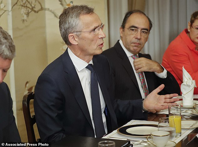 NATO Secretary General Jens Stoltenberg, gestures while speaking to U.S. President Donald Trump during their bilateral breakfast, Wednesday, July 11, 2018 in Brussels, Belgium. (AP Photo/Pablo Martinez Monsivais)