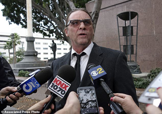 FILE - In this Jan. 8, 2018, file photo, Michael Channels speaks to reporters after a hearing in Los Angeles Superior Court in Los Angeles. A Los Angeles judge has eliminated two purported sons of Charles Manson from the battle over his estate. Judge Clifford Klein on Friday, July 13, 2018, narrowed the case down to a man who says he's the cult leader's grandson and a memorabilia collector, Channels, who was pen pals with Manson. (AP Photo/Brian Melley, File)