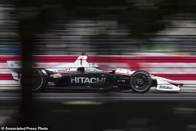Josef Newgarden zooms down the front straight during the first practice session for the Toronto Indy IndyCar auto race in Toronto, Friday July 13, 2018. (Frank Gunn/The Canadian Press via AP)