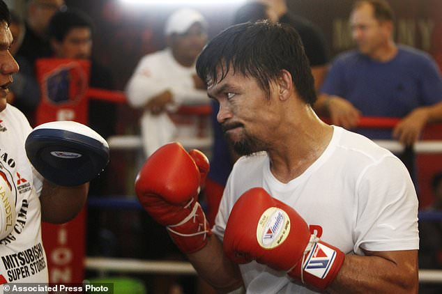 wire 3643622 1531537146 569 634x422 - Pacquiao, Matthysse make weight for welterweight title...