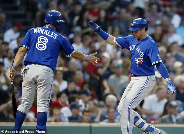 Toronto Blue Jays' Justin Smoak celebrates his solo home run with Kendrys Morales (8) during the third inning of the team's baseball game against the Boston Red Sox in Boston, Friday, July 13, 2018. (AP Photo/Michael Dwyer)