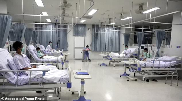 This image was taken on July 13, 2018 and published by Chiang Rai Prachanukroh Hospital. It shows some of the 12 boys who were rescued from the flooded cave in their hospital room at the Chiang Rai Prachanukroh Hospital in Chiang Rai province in northern Thailand. The video was shown during a press conference on Saturday, July 14, 2018 in the hospital. (Chiang Rai Prachanukroh Hospital via AP)