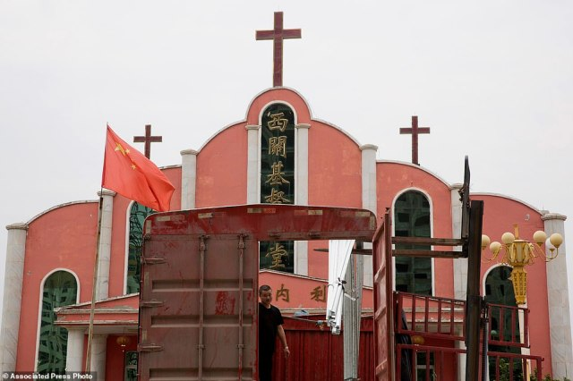A Chinese national flag flies over a church  near the city of Pingdingshan in Henan province. Experts say that President Xi Jinping is waging the most severe systematic suppression of Christianity in the country since 1982