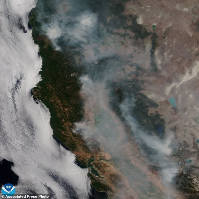 This satellite image, published by NOAA on Tuesday, August 7, 2018, shows forest fires, known as the Mendocino Complex, California. Northern California is struggling with the biggest wildfire in California history, breaking a record set months before. Experts say that this could become the new normal as climate change, in conjunction with the expansion of homes into undeveloped areas, has more intense and devastating consequences. (NOAA over AP)