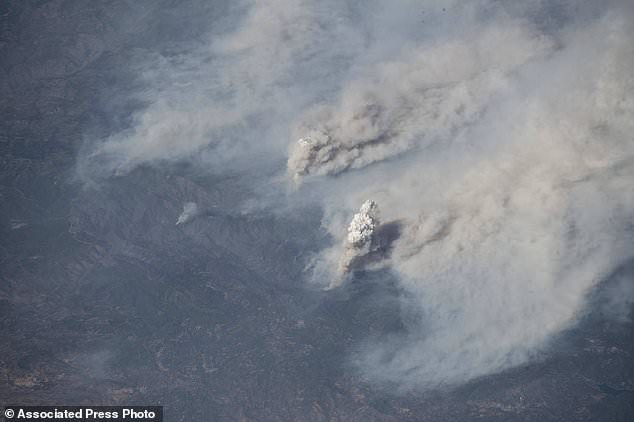 This image, provided by NASA, shows the Californian forest fires that were taken on August 3, 2018 by astronaut Alexander Gerst of the International Space Station. Northern California is struggling with the biggest wildfire in California's history, setting a record only months ago. Experts say that this could become the new normal as climate change, in conjunction with the expansion of homes into undeveloped areas, has more intense and devastating consequences. (Alexander Gerst / NASA on AP)