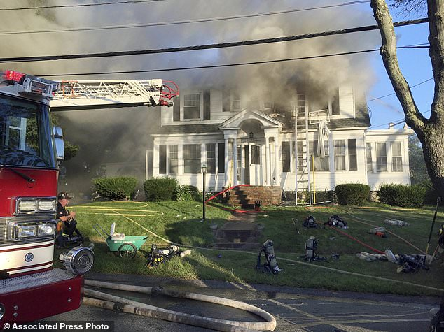 Firefighters are fighting on Thursday, September 13, 2018, at Herrick Road in North Andover, Massachusetts, one of several forces responding to a series of gas explosions and fires triggered by a gas pipeline problem that houses several communities north of Boston. (AP Photo / Mary Schwalm)