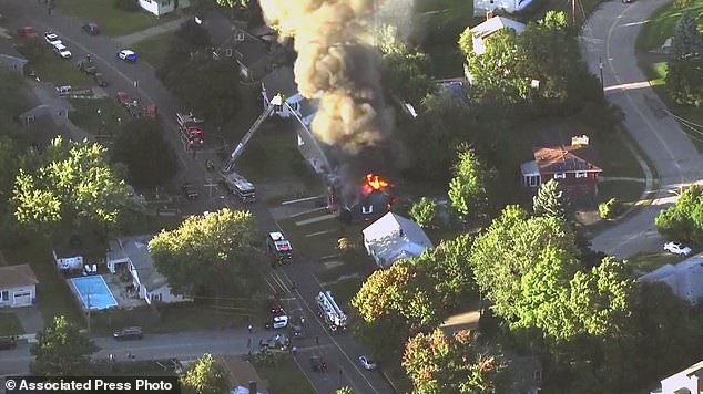 In this picture provided by WCVB in Boston, firefighters are fighting a raging house fire in Lawrence, Mass, a suburb of Boston, Thursday, September 13, 2018. Emergency crews responded to what they believe is a series of Gas explosions have damaged homes in three communities north of Boston. (WCVB via AP)