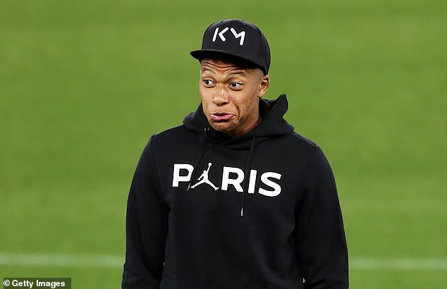 Kylian Mbappe pulls a face as he dons PSG's latest fashion collaboration with Nike Jordan