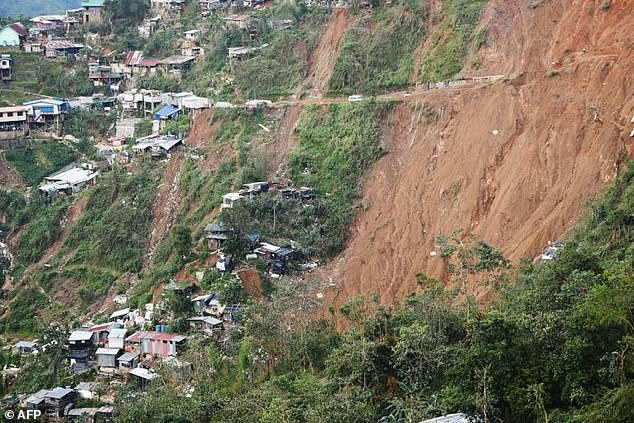 Searchers used shovels and bare hands to claw through mounds of rocky soil in the mountain town of Itogon, where 11 bodies have been pulled from the rubble and dozens more may still be trapped after a landslide buried an emergency shelter