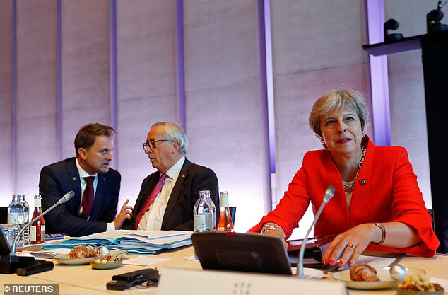 Mrs May put on a brave face as she started crucial talks with EU leaders in Salzburg after several said talks over Brexit are 'at a standstill'. She is pictured with Jean-Claude Juncker (centre) and Luxembourg's Prime Minister Xavier Bettel (right)