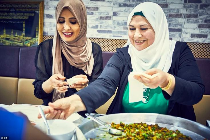 Halima Al-huthaifi and Ahlam Saeid enjoy the food in the Hubb Community Kitchen in West London