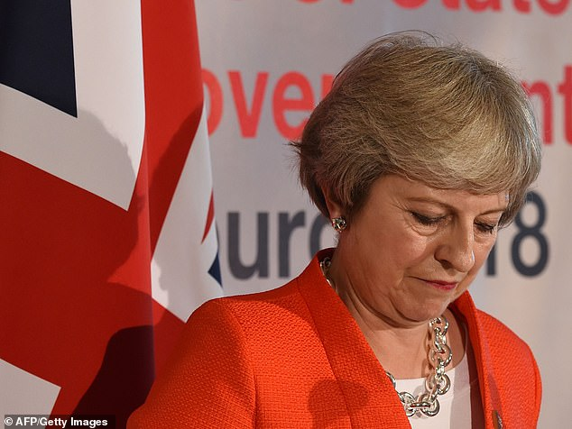 Theresa May was seen shaking with anger after being ambushed by EU leaders at a conference that left the Chequers deal hanging by a thread
