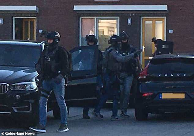 Heavily armed Dutch police arrested seven men accused of planning a major terror attack following raids in Arnhem (pictured) and Weert