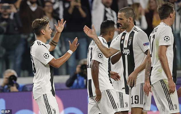 Dybala is congratulated by Bonucci after putting his team in firm control of Tuesday's game