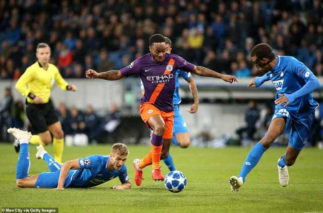 Raheem Sterling of City leaves Hoffenheim's Stefan Posch (left) on the floor following a mazy run through midfield