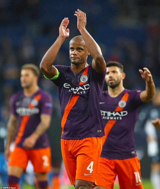 Kompany leads his players over to the travelling City fans inside the stadium after their victory in Germany