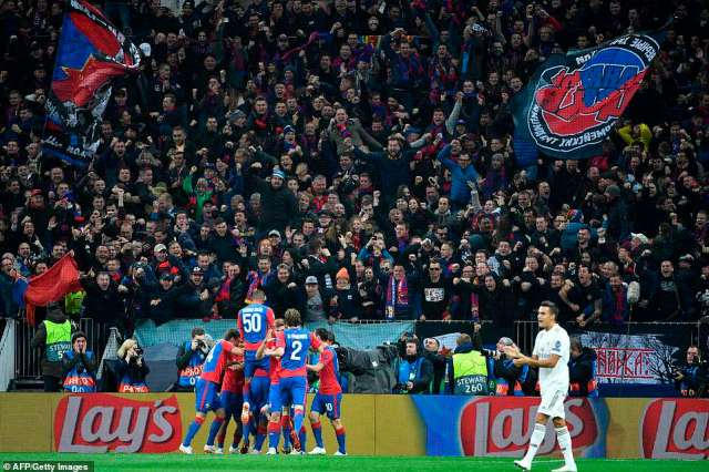The CSKA Moscow players go wild in the corner as they celebrate taking an early lead against the defending champions