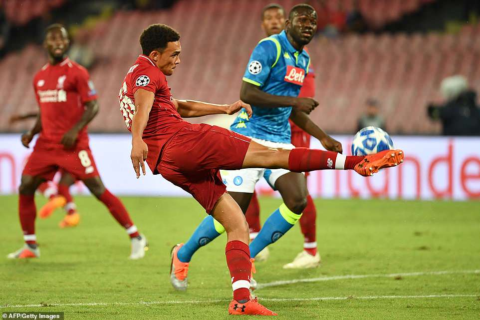 Liverpool's English defender Trent Alexander-Arnold clears the ball from his penalty box to thwart an attack from Napoli