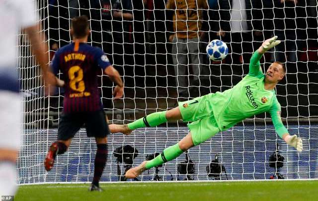 Barcelona midfielder Arthur, left, watch his goalkeeper Marc-Andre ter Stegen make a smart save to keep their lead intact