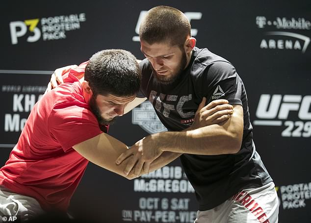 Nurmagomedov throws a training partner to the floor as he goes through his routine