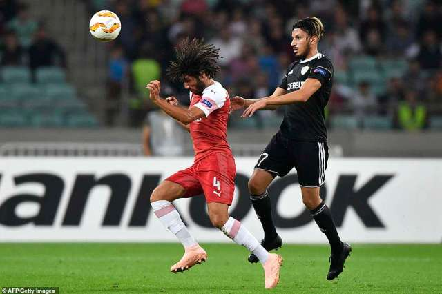 Elneny jumps up for a header under the pressure of Abdellah Zoubir during the opening stages of the European clash