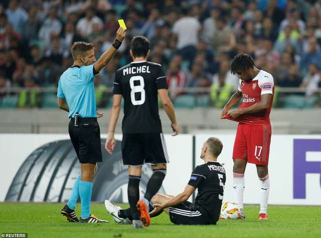 The referee,Davide Massa, shows the Qarabag skipper the yellow just moments after Iwobi pushed him to the ground