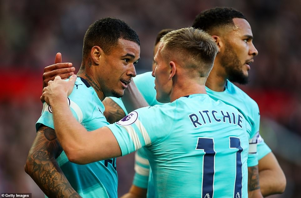 The 22-year-old is congratulated by his Newcastle team-mates after putting the visitors in front against United at Old Trafford