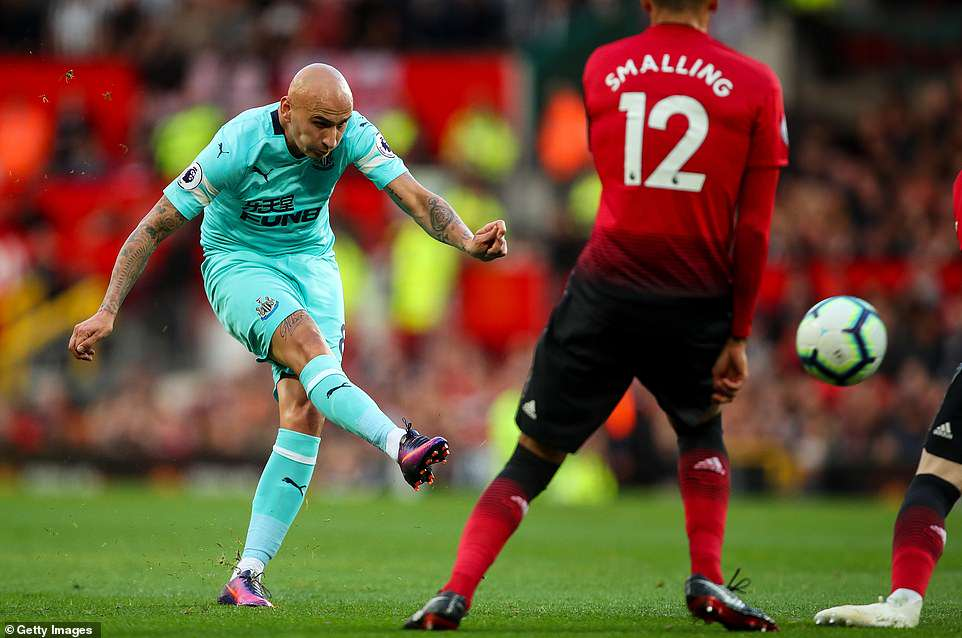 Newcastle midfielder Jonjo Shelvey goes for goal as he attempts to inflict further misery upon a struggling United side