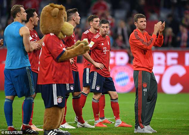 Bayern players applaud fans after loss, which saw the club move down to fifth in league table