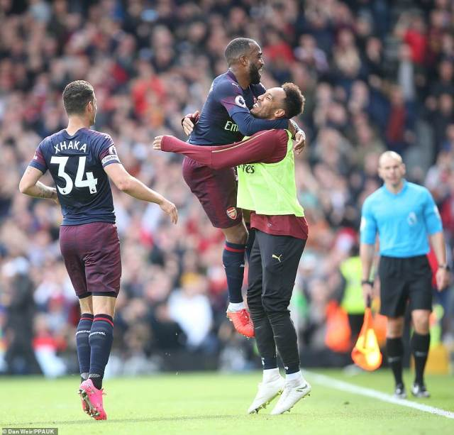 Pierre-Emerick Aubameyang had to watch the Lacazette masterclass from the bench but was clearly happy for his teammate