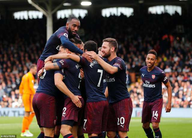Aaron Ramsey was mobbed by his team-mates after scoring a stunning heel flick just 38 seconds after coming off the bench