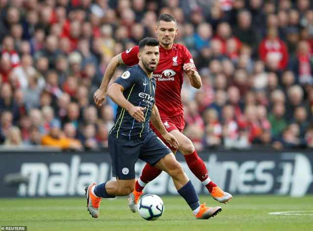 Sergio Aguero is chased by Liverpool defender Dejan Lovren after supporters were treated to an electric start by both teams