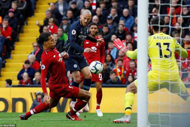 Virgil Van Dijk makes a last-ditch challenge to deny David Silva a shot at goal after a well-worked move from Guardiola's side