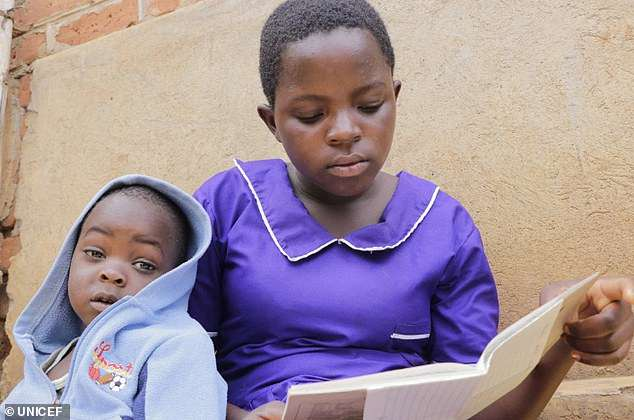 Edna was married when she was 15 years old after falling pregnant (pictured with her baby). After escaping the marriage, she has returned to school and is carving out a future