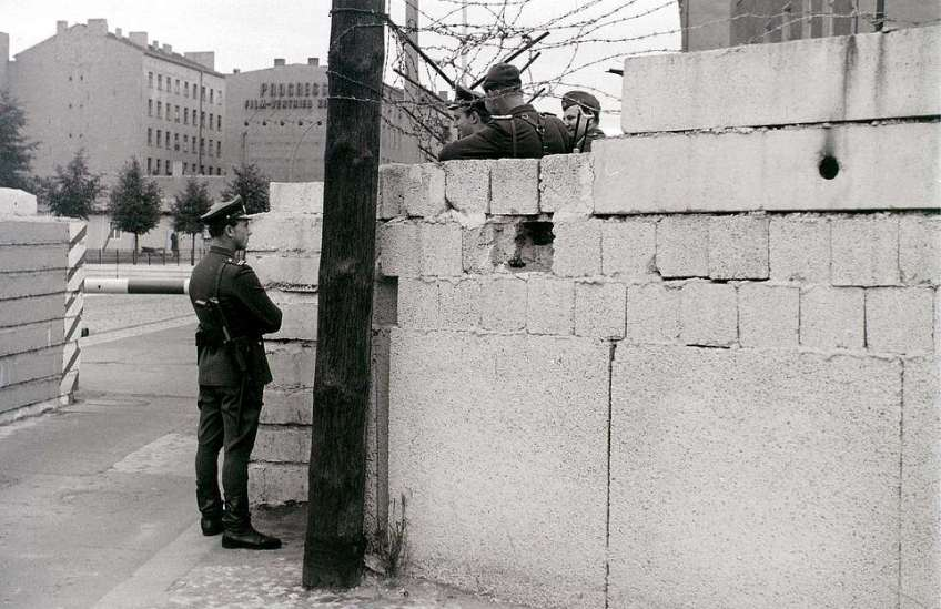 Mr Hailstone was able to take this shot at Chausseestrasse in East Berlin in August 1962 without being approached by the People's Police because he was standing about a metre inside West Berlin. He said: 'The border guards are clearly enjoying their work. The officer standing on this side of the Wall was clearly a very trusted individual, and it is unclear whether the others would have been given orders to shoot him if he had made a run for it'