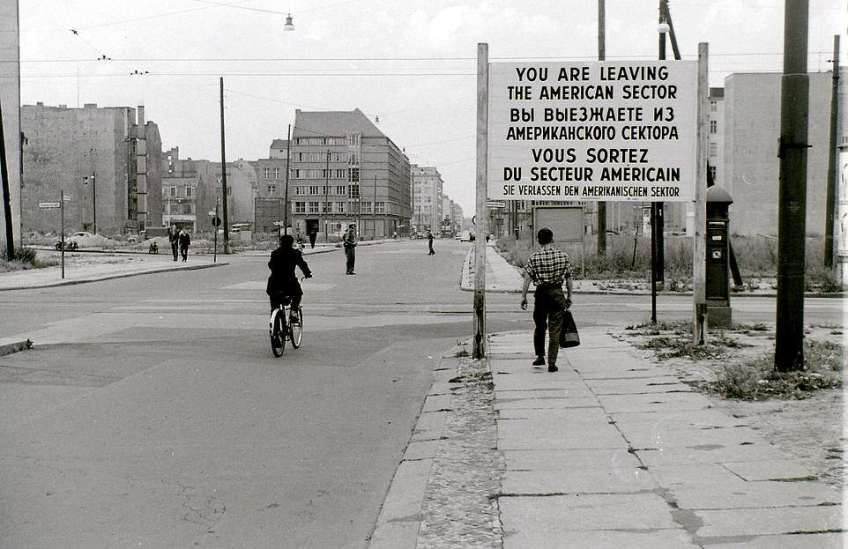 A shot that looks north along Friedrichstrasse from West Berlin into the East in July 1960. The cyclist is about to cross Zimmerstrasse, along which ran the white line marking the border after Checkpoint Charlie came into force. Mr Hailstone said when he took this shot, he did not appreciate that this location would become world famous and, although many photographs of Checkpoint Charlie now exist, there are probably few which show how this crossing appeared before August 1961
