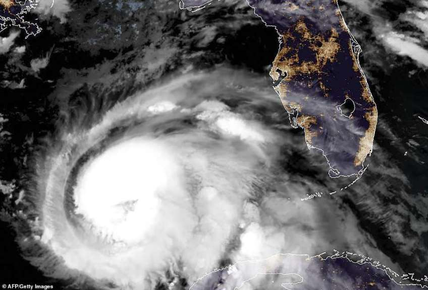 Mass evacuations have been ordered as a 'monstrous' Hurricane Michael strengthened into a Category 2 storm on Tuesday with top wind speeds of 100 mph as it continued to intensify on its path toward the Florida Panhandle