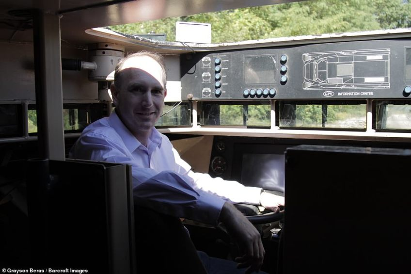 GPV Colonel truck owner, Ted Yadlowsky, sits in the driver's seat and smiles to the camera on October 23, 2018 in Lake Orion, Michigan
