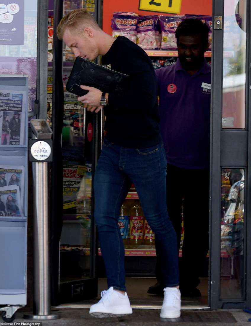 Busy: He popped into a nearby shop to get some provisions before heading back to the station