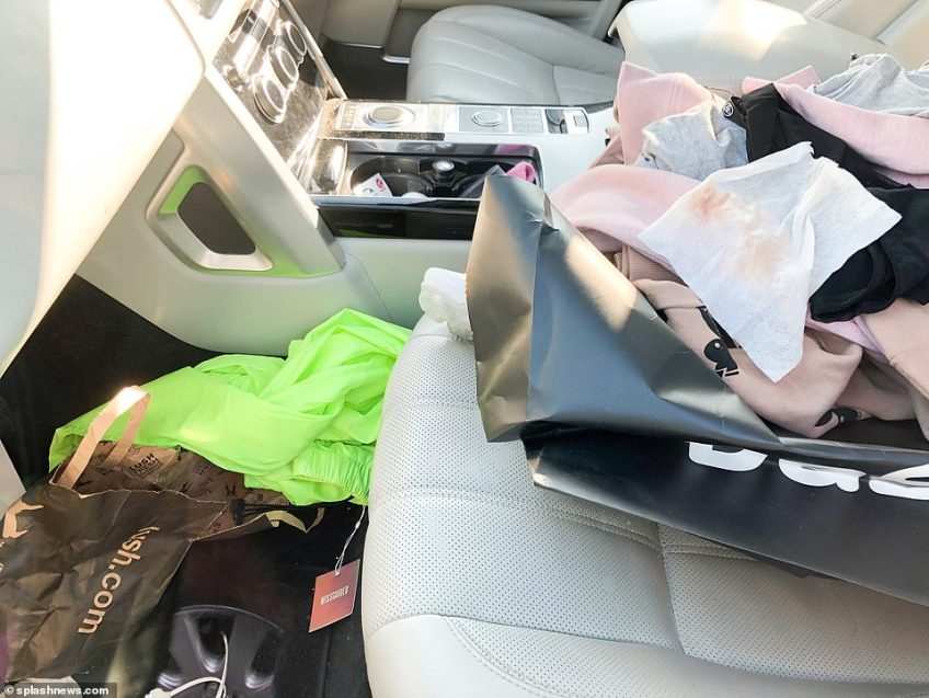 The messy interior of Katie Price pink 4x4 left parked up after she was arrested for alleged drink driving on Shooters Hill, south-east London