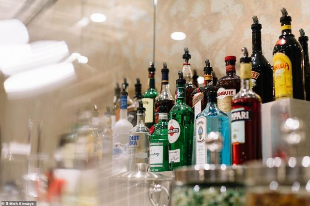 The drinks behind the fully-stocked opulent bar in the first class lounge at JFK's Terminal 7
