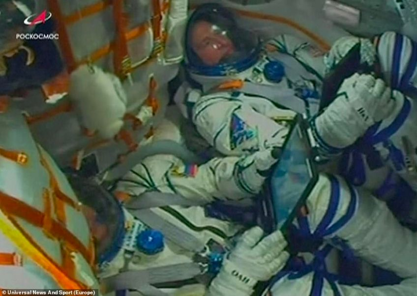 The two-man crew ofNASA rookie Nick Hague and second-time flyer Aleksey Ovchinin in the cockpit of the spacecraft during take-off. Hague had never been aboard a space shuttle before Thursday's launch, with Ovchinin only having been into space once during a previous six-month posting to the International Space Station