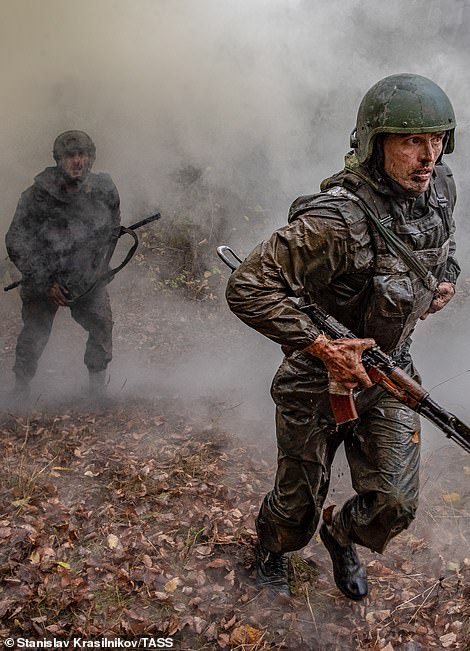Maroon beret contenders duck as they are sprayed with smoke