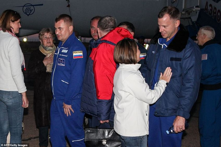 The two men were reunited with their familiesafter landing at the Krayniy Airport in Baikonur, Kazakhstan later on Thursday