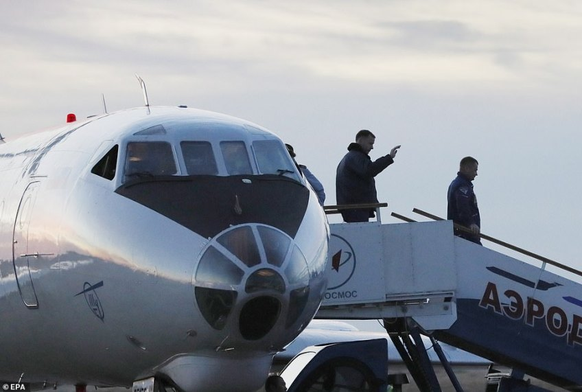 US astronaut Nick Hague, left, and Russian cosmonaut Alexey Ovchinin, right, arrived at theBaikonur airport in  Kazakhstan just hours after their narrow escape