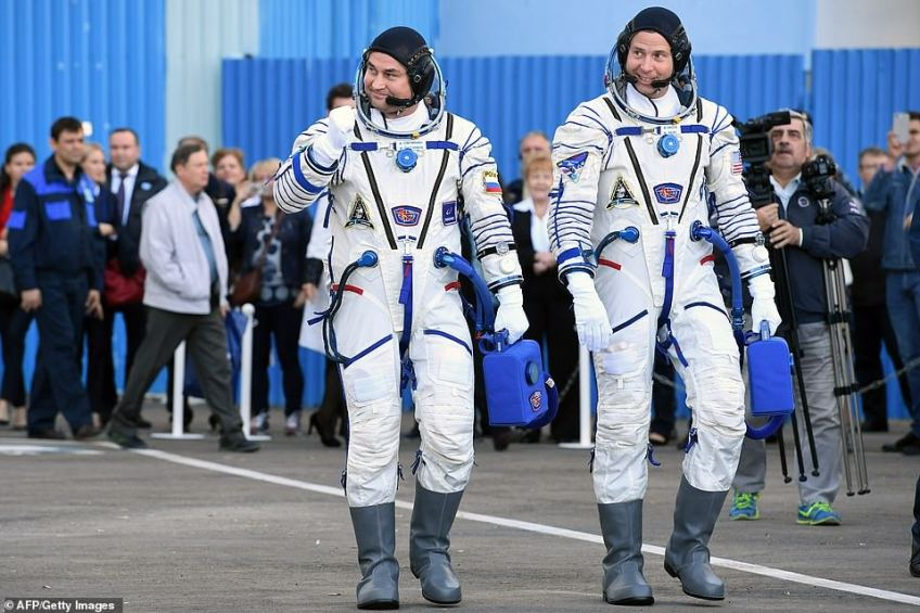 NASA astronaut Nick Hague (right) and Roscosmos cosmonaut Alexey Ovchinin walk toward the shuttle after their space suits were tested prior to the launch on Thursday.The astronauts were due to dock at the International Space Station six hours after the launch, but the three-stage Soyuz booster suffered an unspecified failure of its second stage