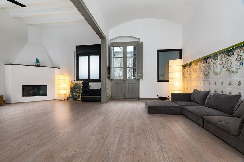Spacious: It's distributed over three floors with stairs leading up to a storage room on the top floor