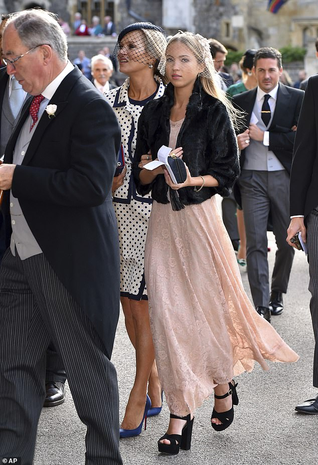 Stunner:Kate opted for a Fifties-inspired ensemble as she wowed in the black and white dress with a matching jacket worn over the top and blue heels added in